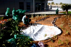 Geotextile being laid over water feature